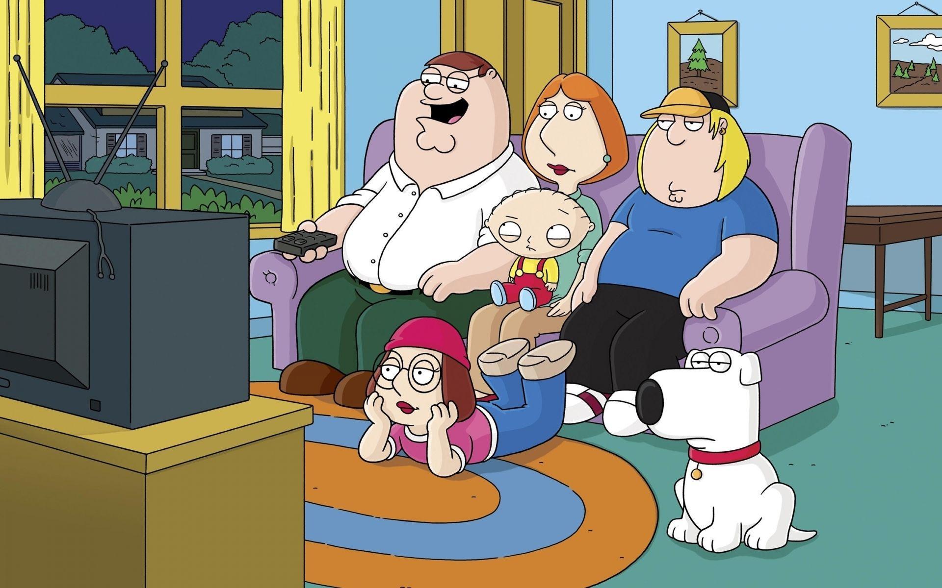 Padre de familia viendo tv